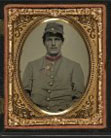 [Unidentified soldier in Confederate artillery jacket with secession badge and artillery forage hat]