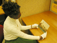 Staff member examining a photochrom print