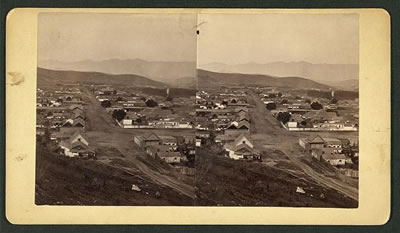 Unidentified city or town, aerial view, with mountains in the background