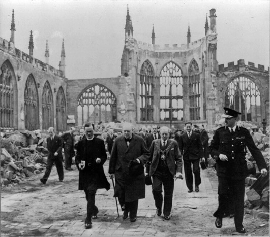 Prime minister winston churchill walks through the ruins of coventry