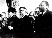 Abraham Joshua Heschel walks with Martin Luther King Jr.