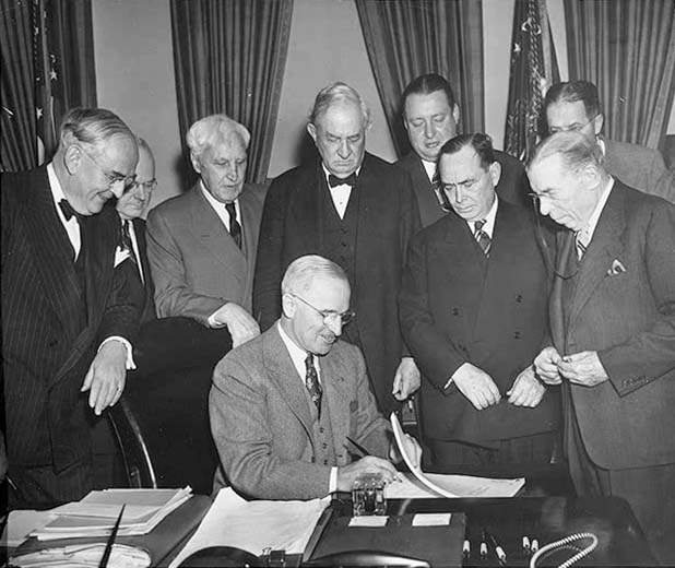 President Truman signing legislation to create the Marshall Plan, 1948 - Library of Congress, Averill Harriman collection