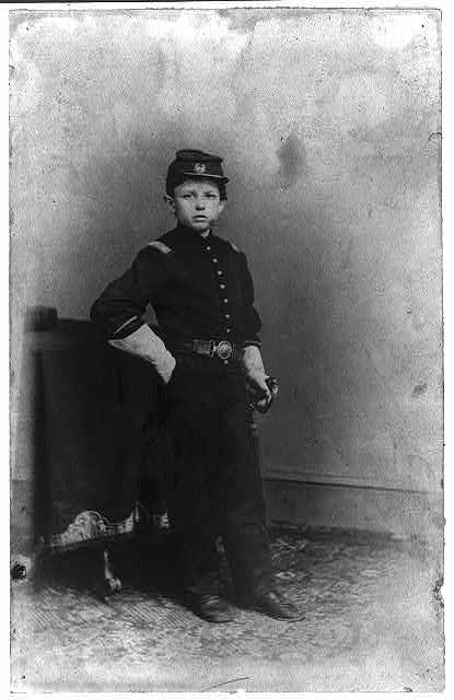 "Thomas ""Tad"" Lincoln, Abraham's fourth son at the White House dressed as a Union soldier"