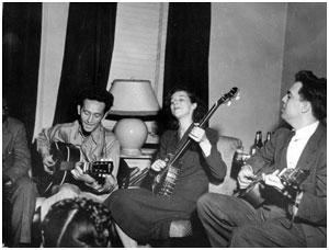 Sonny Terry (obscured), Woody Guthrie, Lilly Mae Ledford, Alan Lomax, New York, 1944.