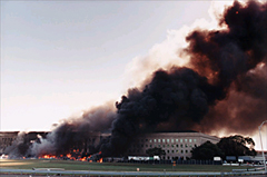 The Pentagon burns after being hit by a hijacked airliner