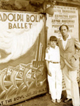 Bolm and son in front of a promotional display before the troupe's performance at the Hollywood Bowl, ca. 1932