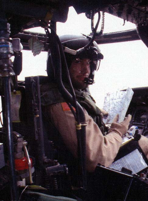 Army capt drew larson in the cockpit of a blackhawk helicopter in
