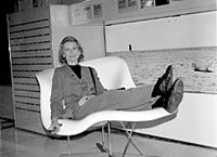 Lucia Eames, daughter of designer Charles Eames, reclines in one of the chairs her father and stepmother, Ray Eames, designed and created.