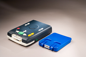 Digital talking book player and mailing container for book.