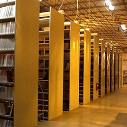Rows of shelves containing the foreign-language braille collection at the NLS Multistate Center East, in Cincinnati, Ohio