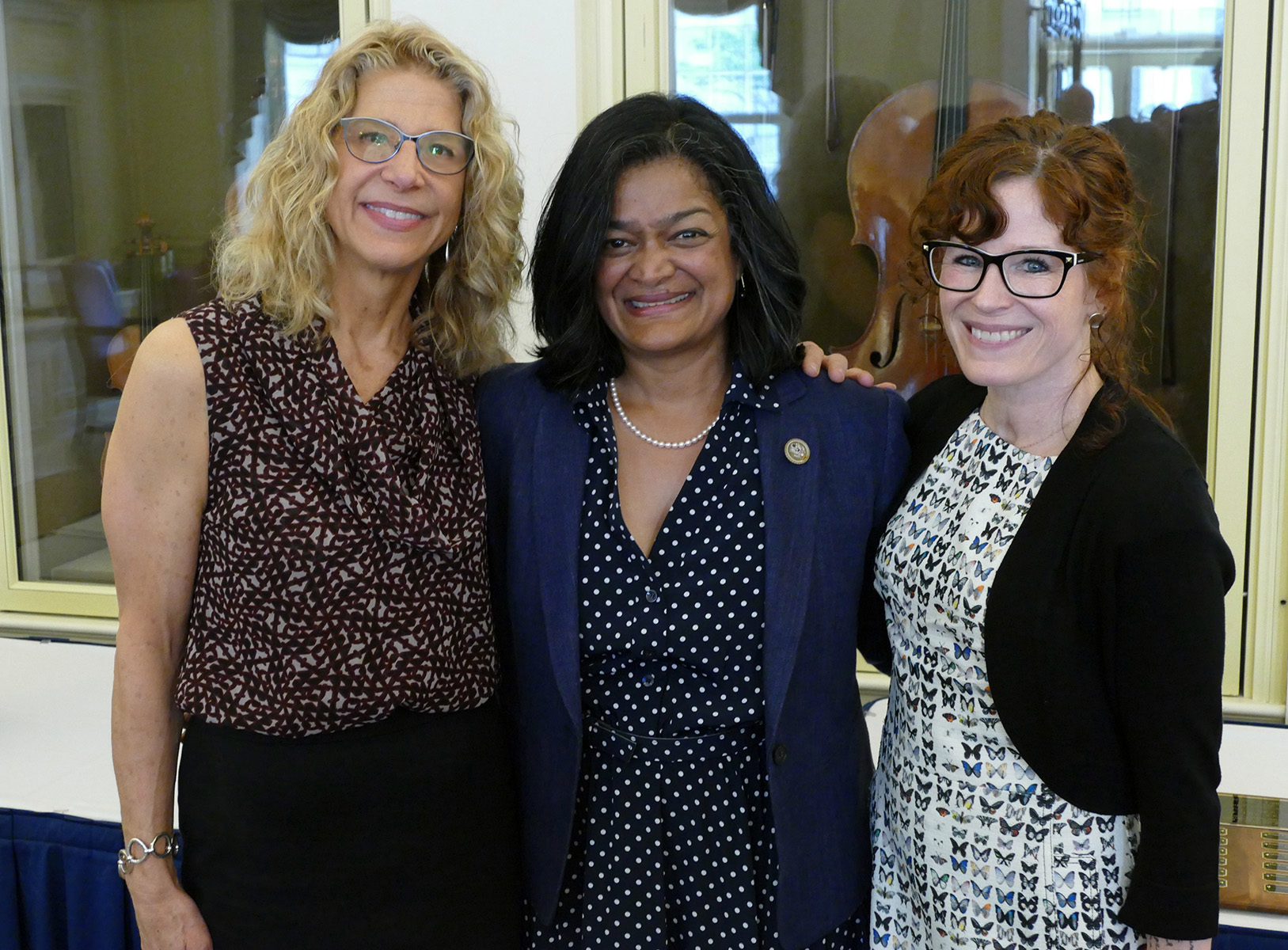Pramila Jayapal, Danielle Miller, and Cindy Aden stand together