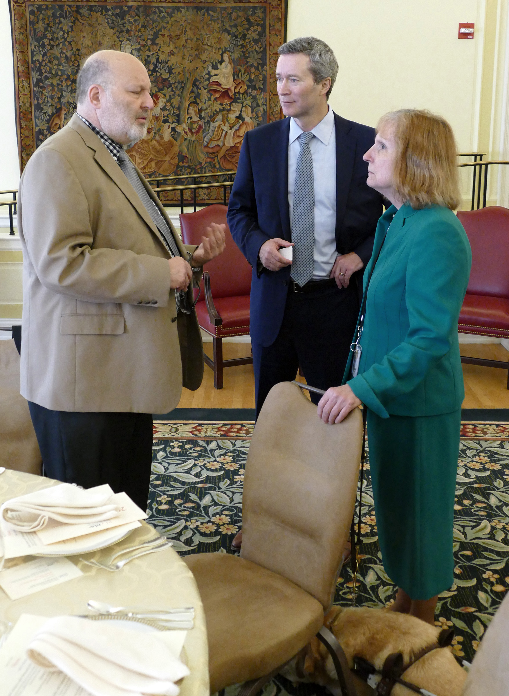 Allan Kleiman, Eugene Flanagan, and Karen Keninger stand next to a table