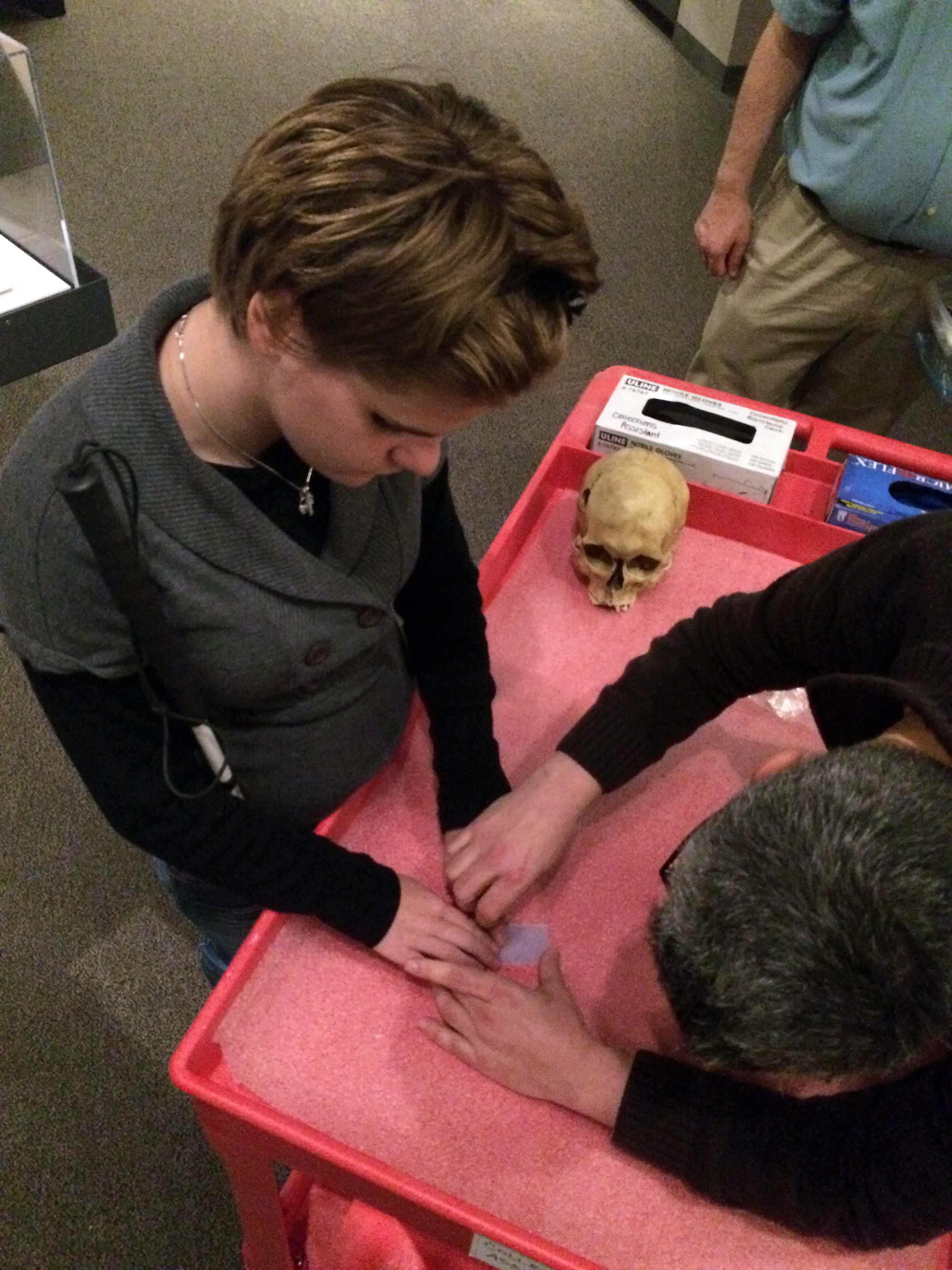 Kimmy Drudge touches a 3D-printed artifact