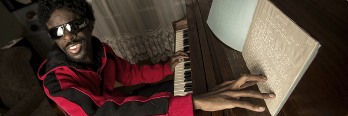 Pianist Jermaine Gardner of Baltimore, Maryland, practices with a braille music score