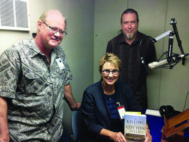 Author Terry Shames poses in the studio with her novel A Killing at Cotton Hill along with Ric Furley and Miles Lewis.