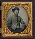 [Unidentified young soldier in Confederate shell jacket, Hardee hat with Mounted Rifles insignia and plume with canteen and cup]