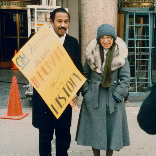 Rosa Parks and U.S. Congressman John Conyers Jr., picketing in front of General Motors corporate headquarters, Detroit, Michigan.