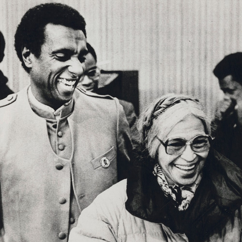 Black activist Kwame Toure (L) formerly known as Stokley [i.e. Stokely] Carmichael ... at the University of Michigan to discuss civil rights at a forum. Another civil rights leader Roas [i.e. Rosa] Parks (R) has a lighter moment with Toure after a panel discussion.