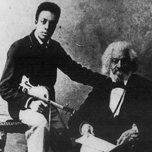 Frederick Douglass with his grandson Joseph H. Douglass, a concert violinist, ca. 1886.  Photograph.