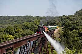 A steam train operated by the Boone & Scenic Valley Railroad, crosses the Bass Point Creek Bridge