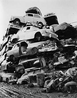 Pile of discarded automobiles in a junkyard...New York, Department of Sanitation, 1957.