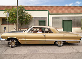 Jesse Garcia shows off his shiny, low-slung, two-door 1963 Chevy Impala in Tucson, Arizona...