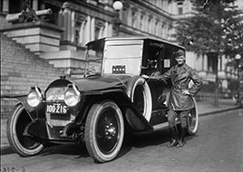 Man with automobile in front of State, War and Navy Building, Washington, D.C...1915-1923.