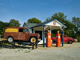 Re-creation of an early gasoline station and repair shop outside the National Automobile and Truck Museum in Auburn, Indiana...