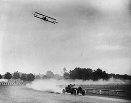 Race between Lincoln Beechey in airplane and Barney Oldfield in automobile...1912.