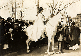 Inez Milholland Boissevain, wearing white cape, seated on white horse at the National American Woman Suffrage Association parade, March 3, 1913, Washington, D.C. Photo by Bain News Service, 1913