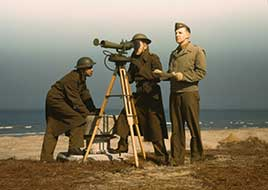Men of Fort Story operate an azimuth instrument, to measure angle of splash in sea-target practice...