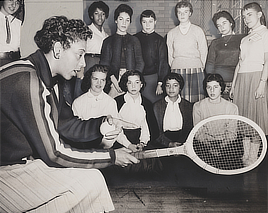 Tennis talk. Althea Gibson, U.S. and Wimbledon tennis champion, gives some pointers on the game ... Some 500 students attended the tennis clinic yesterday .... World Telegram & Sun photo by Ed. Ford, 1957