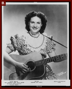 [Kitty Wells, half-length portrait, facing front, holding guitar], 1956. Prints and Photographs Division.